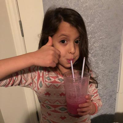 Girl drinking a fruit drink with a straw