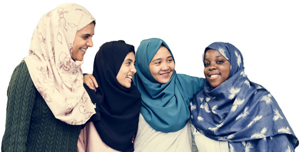 Photo of four young women smiling in hijab