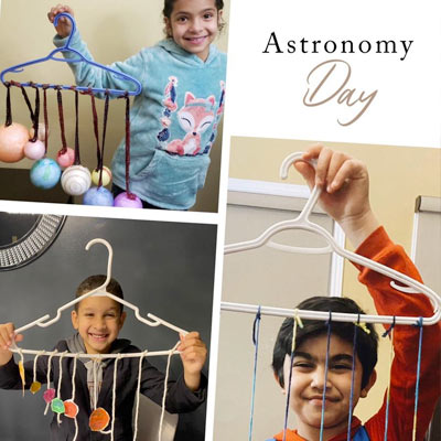 Smiling children with their planet mobiles they created for astronomy day